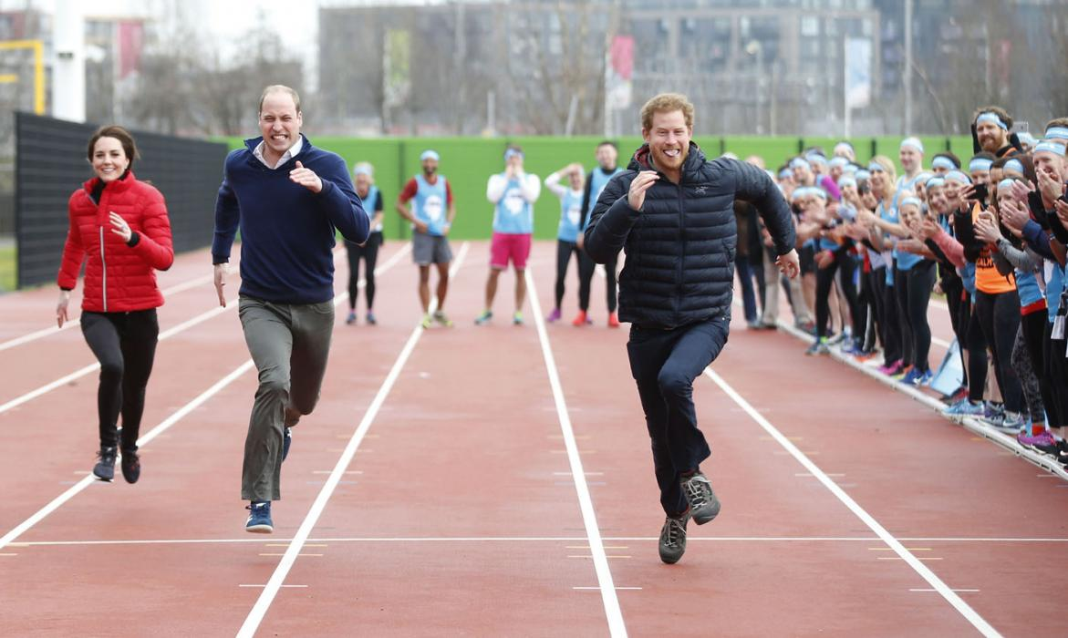 The Duke and Duchess of Cambridge and Prince Harry take part in a race for Heads Together