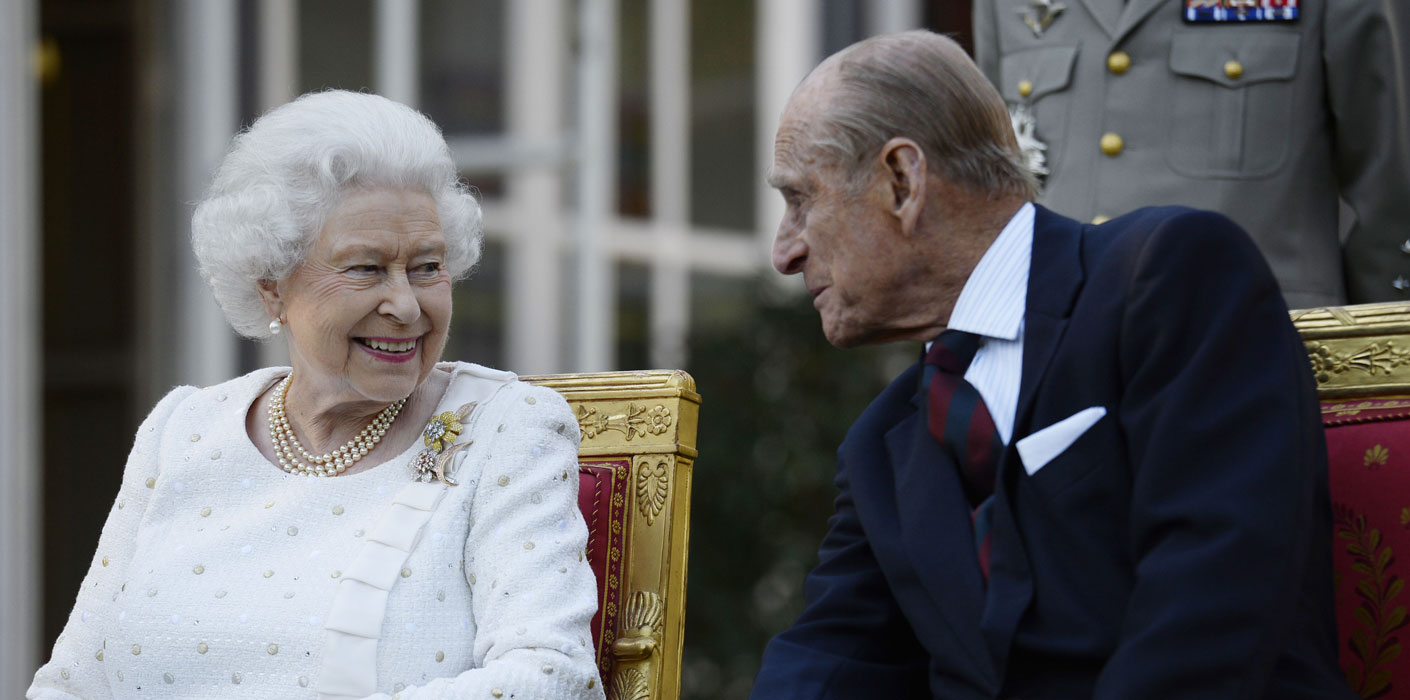 The Queen and The Duke of Edinburgh talking animatedly to each other