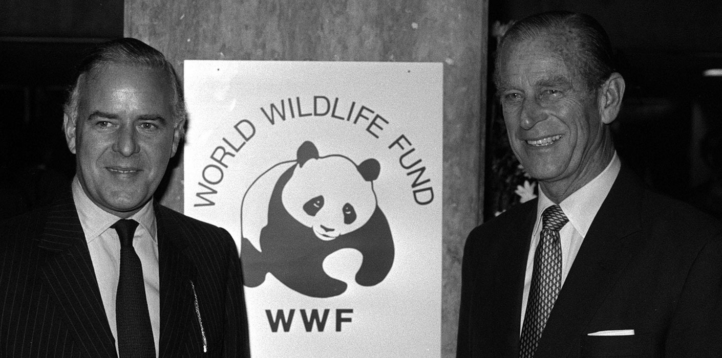 The Duke of Edinburgh in front of a World Wildlife Fund poster