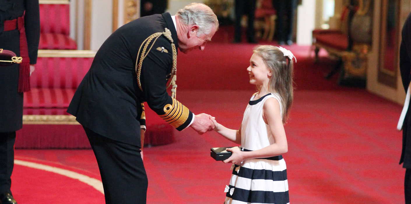 Ten-year-old Ella receives the CBE awarded to her late grandmother, Jill Tookey, founder of the National Youth Ballet