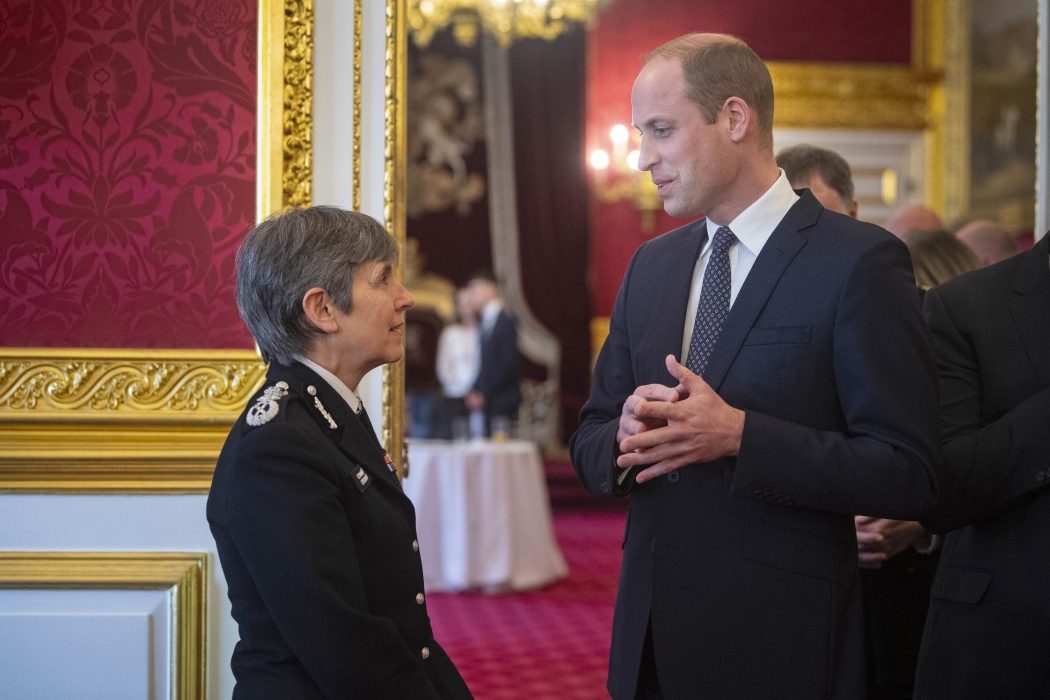 The Duke of Cambridge speaks with a Police Officer at a reception to mark 150 years of the Metropolitan and City Police Orphans Fund