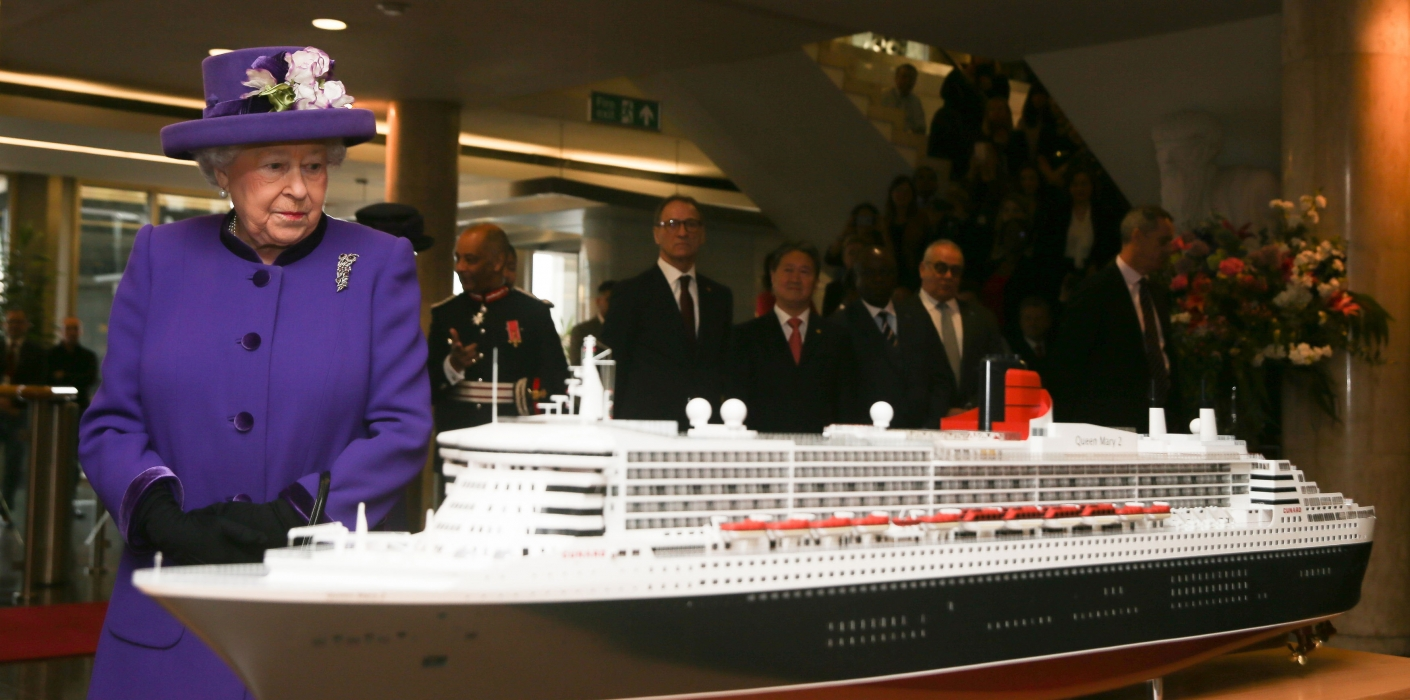 The Queen views a model of a ship