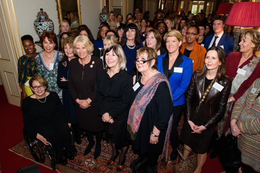 The Duchess of Cornwall, President of WOW - the Women of the World Festival, poses with guests following a reception at Clarence House.