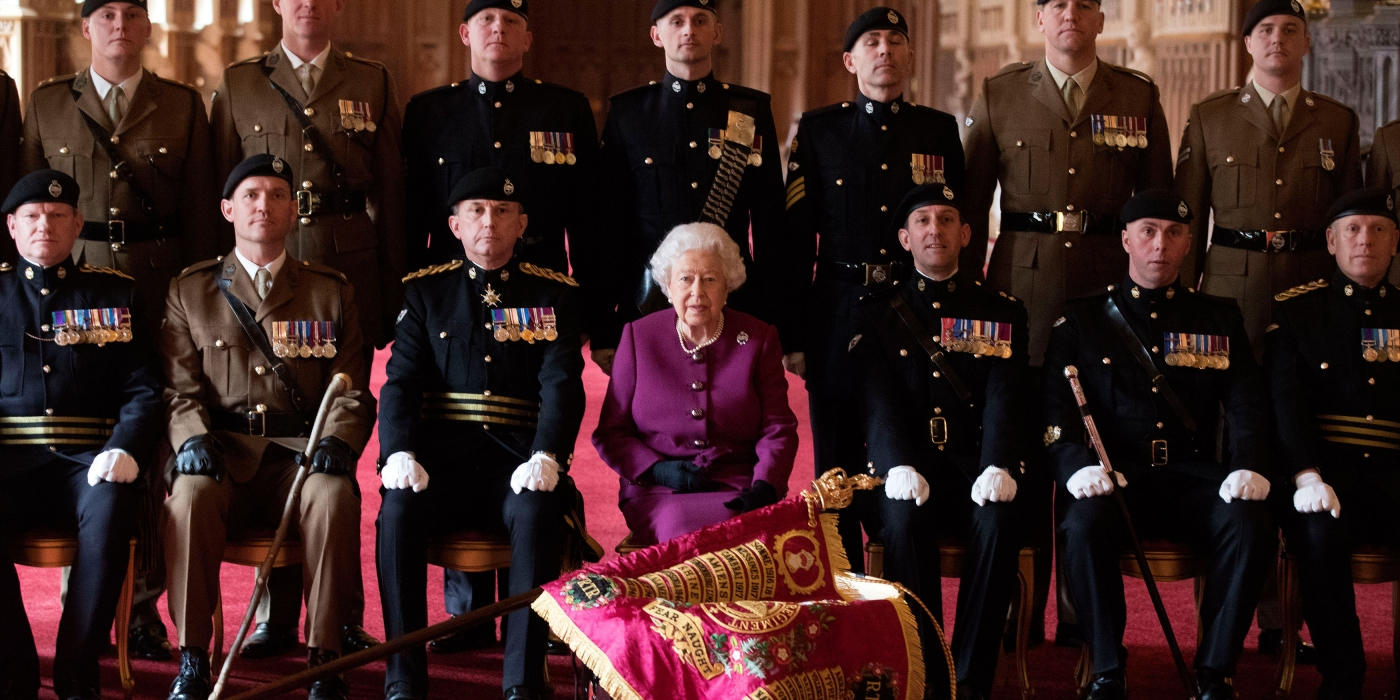 The Queen presents a new Standard to the Royal Tank Regiment.