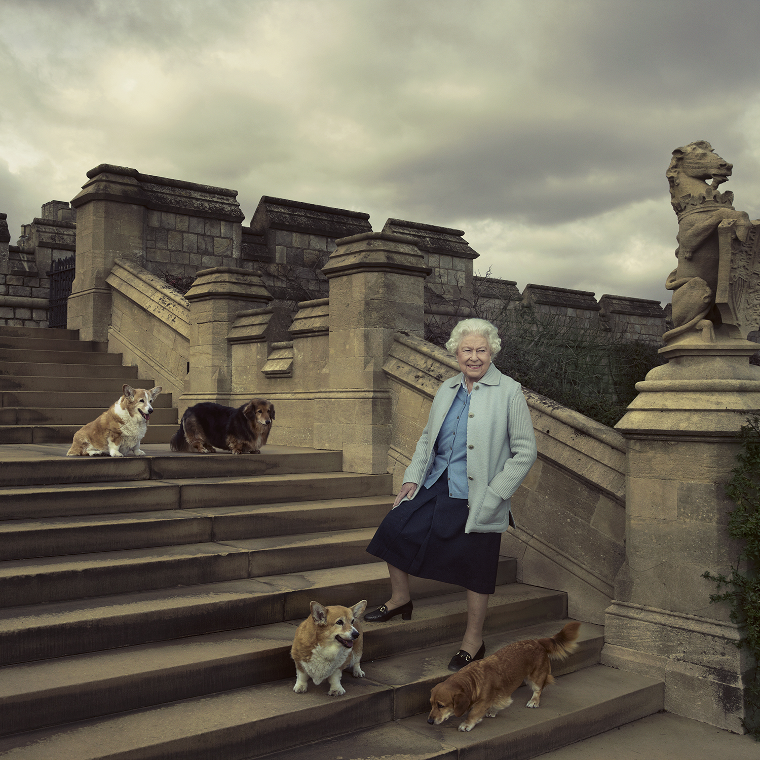 The Queen with her Corgis and Dorgis