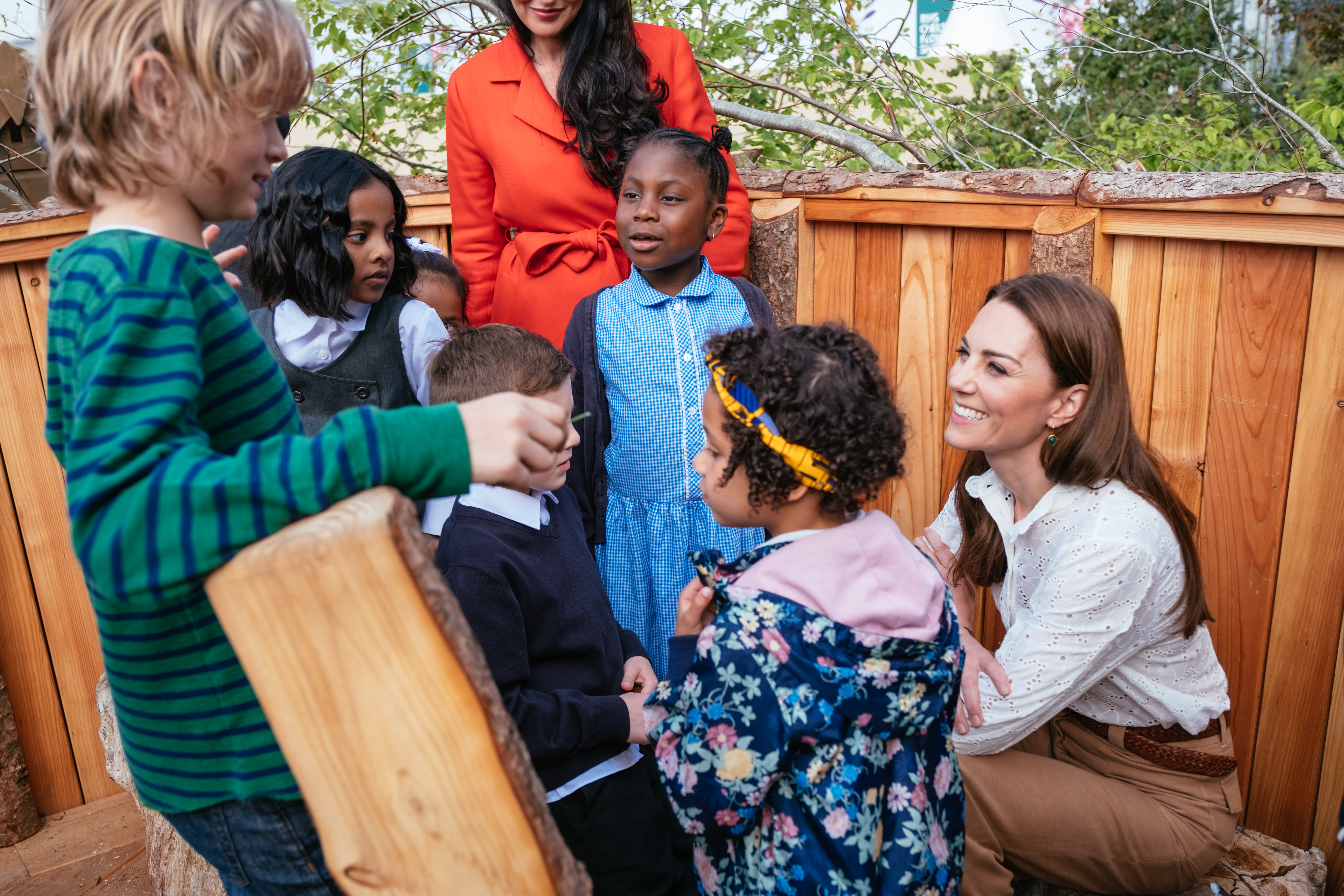 The Duchess of Cambridge and local schoolchildren explore the RHS Back to Nature Garden at the Chelsea Flower Show.