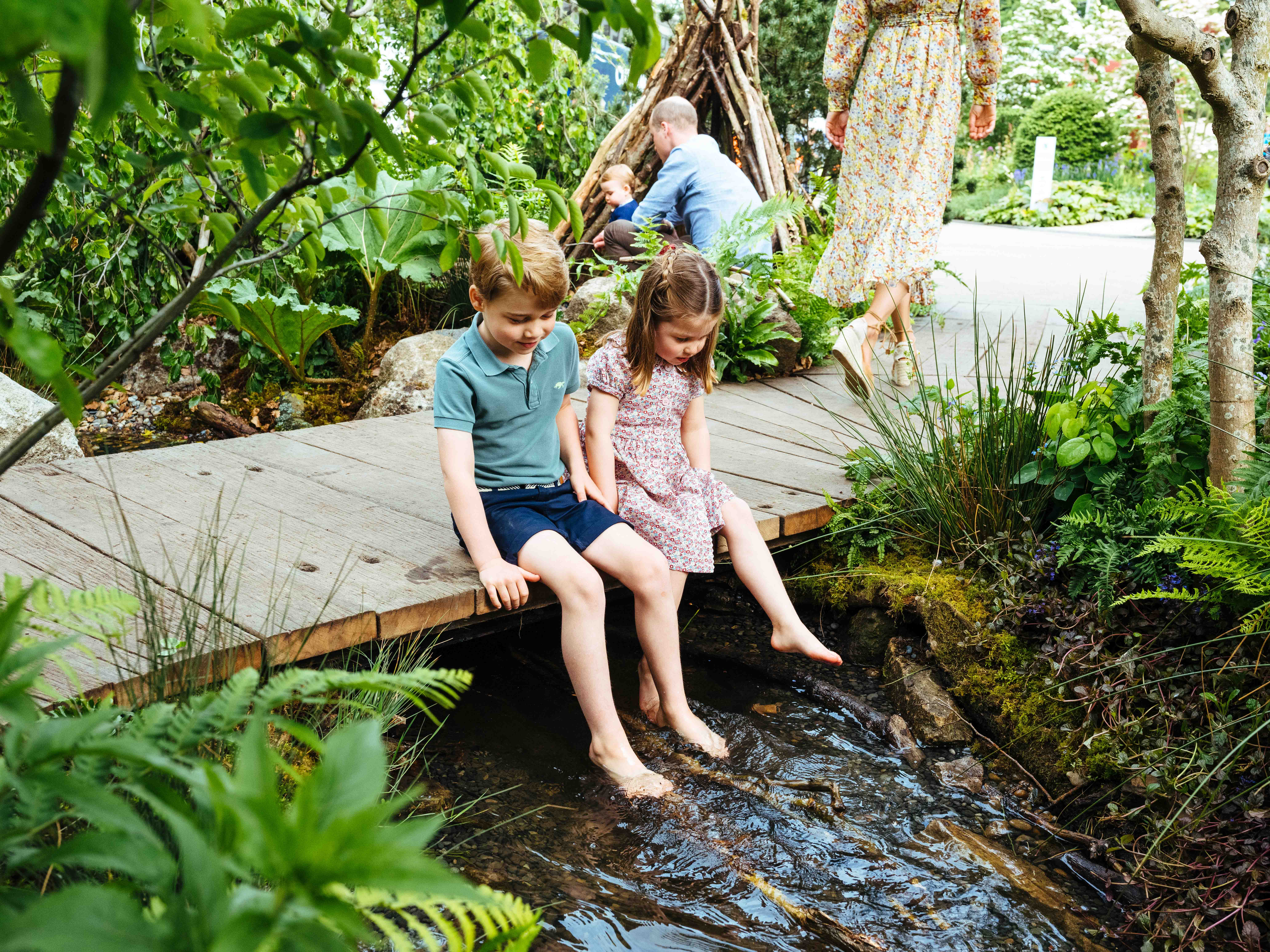 Prince George and Princess Charlotte explore the RHS Chelsea Back to Nature Garden.