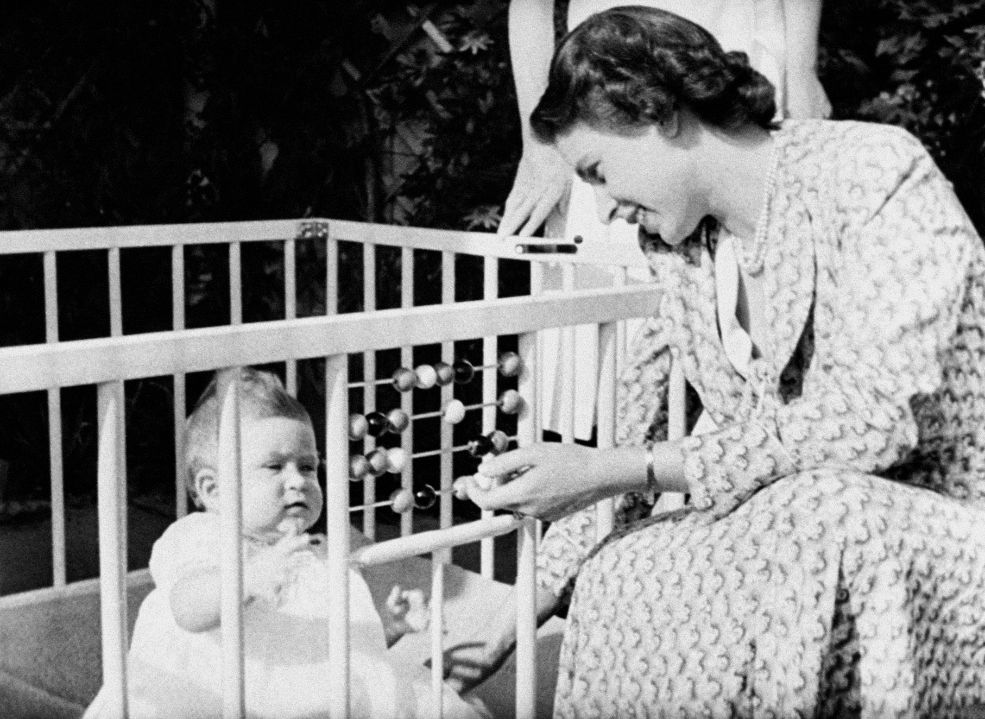 The queen and the prince of wales as a baby