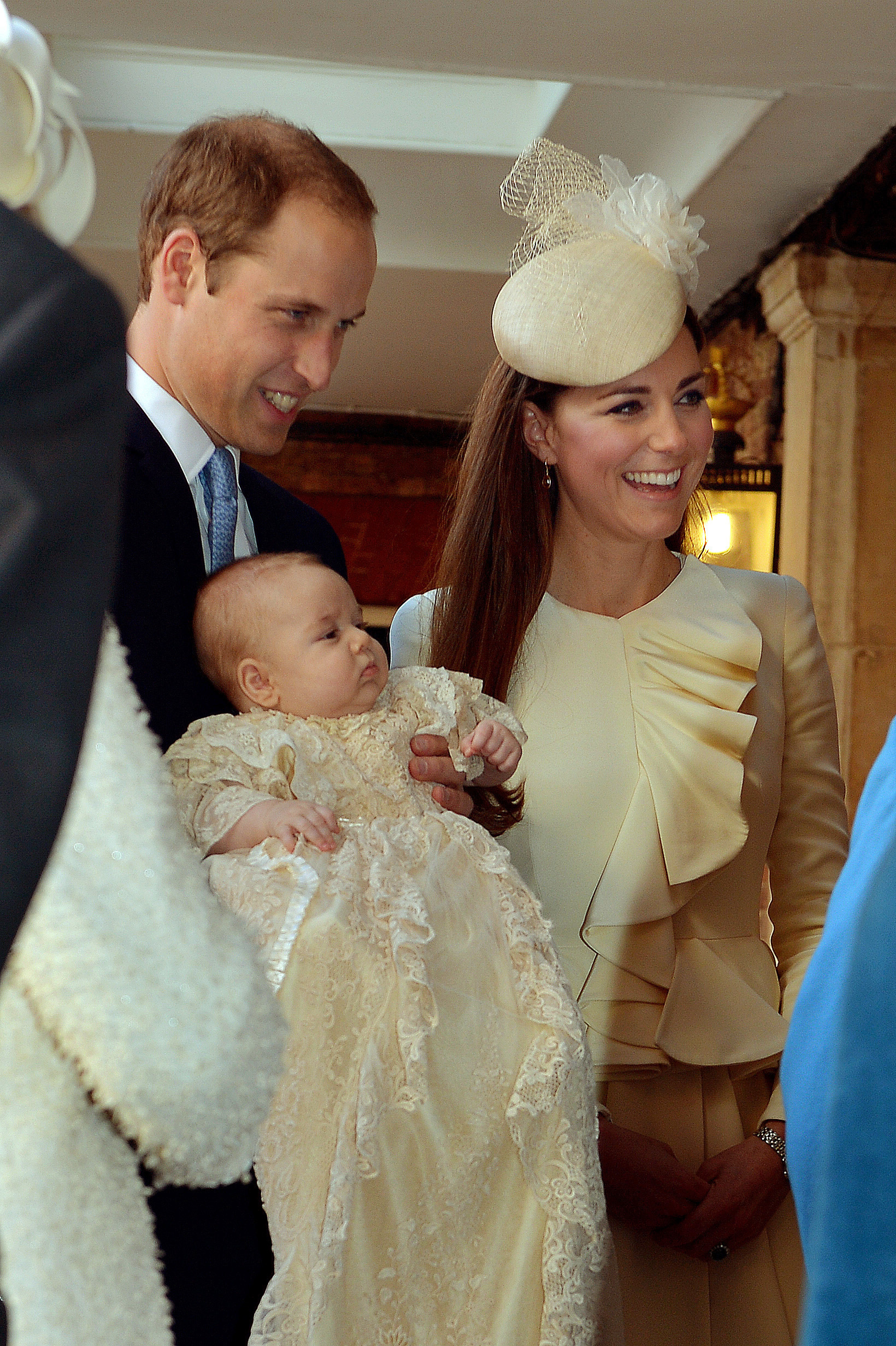 The Duke and Duchess of Cambridge with Prince George at his Christening