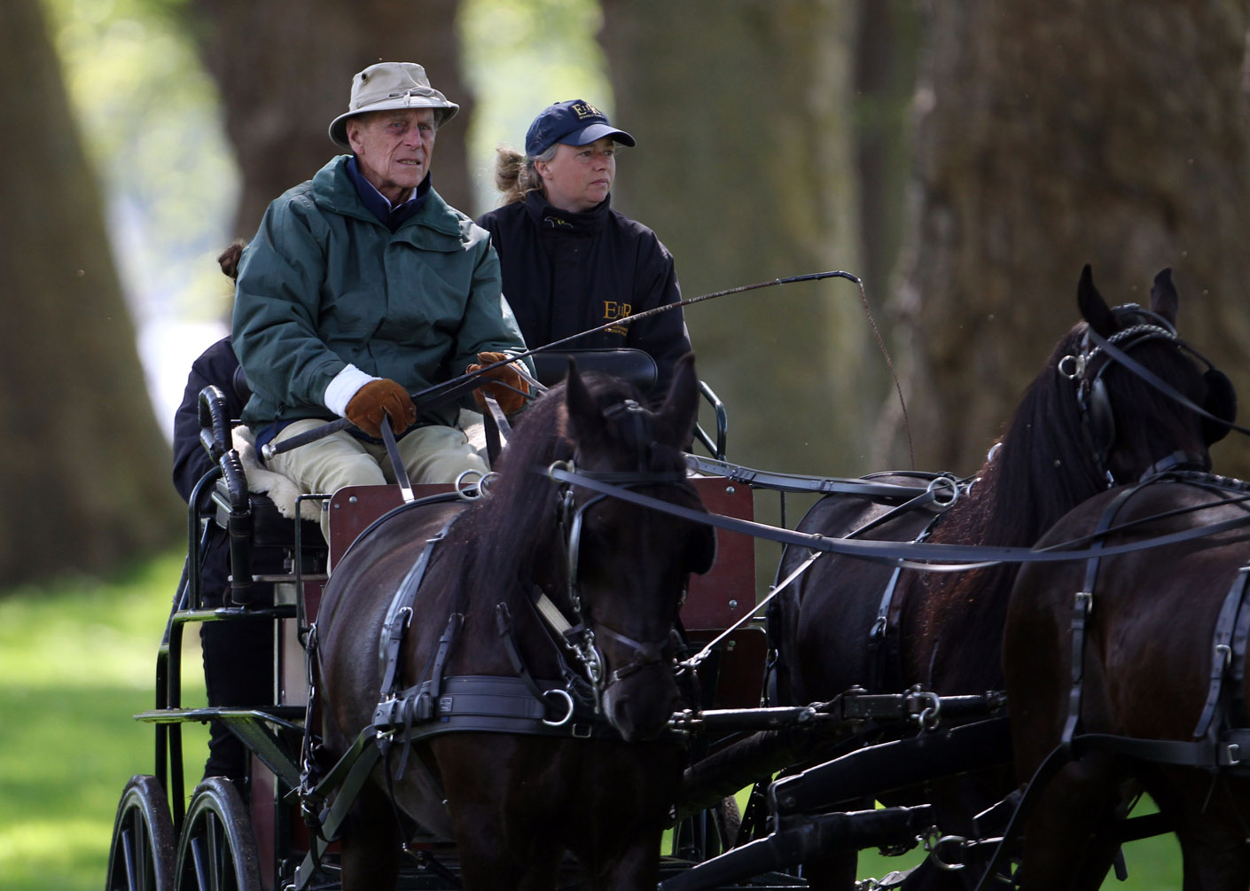 The Duke of Edinburgh drives a carriage at Windsor Castle