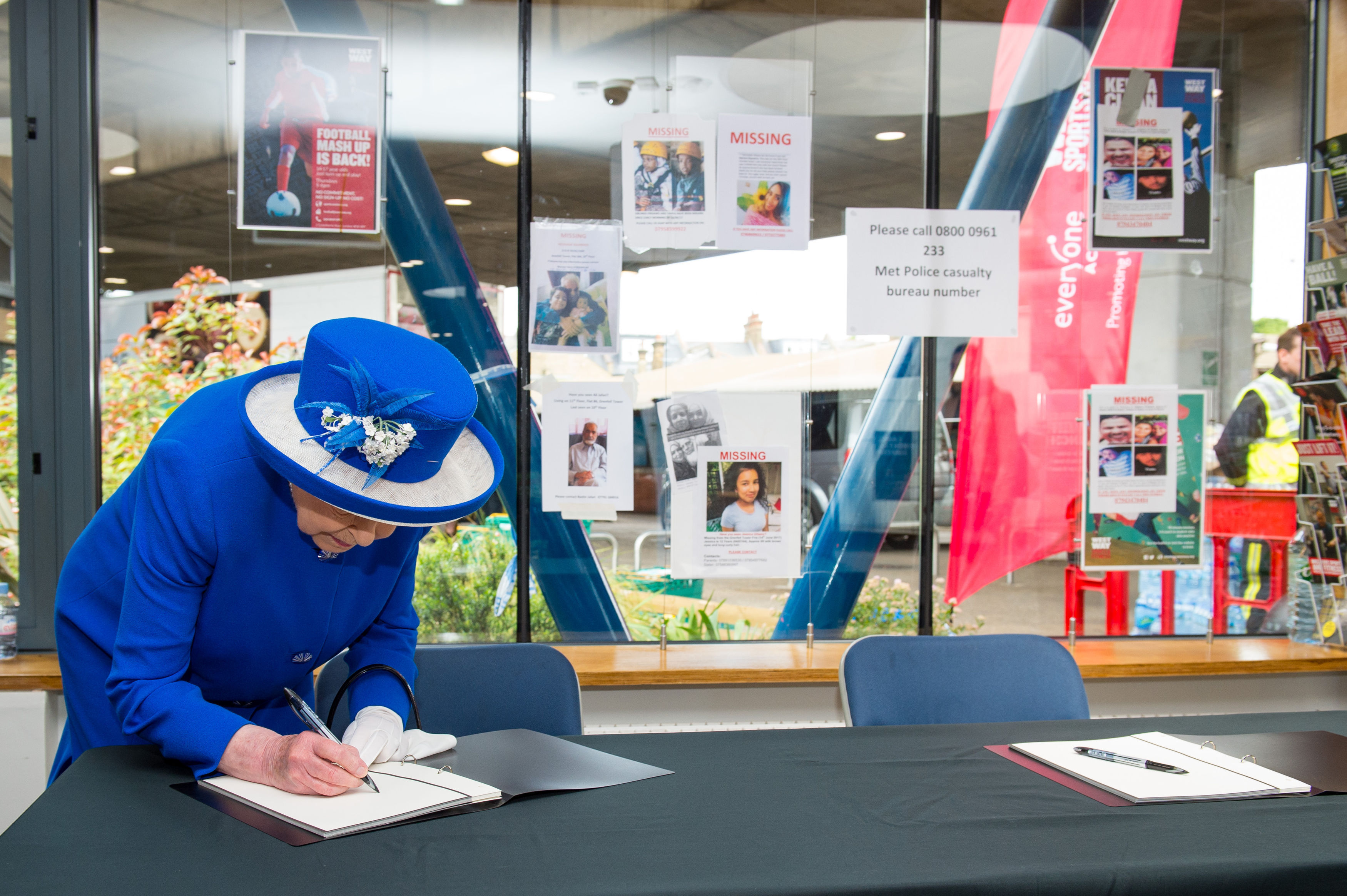 The Queen signs the book of condolence