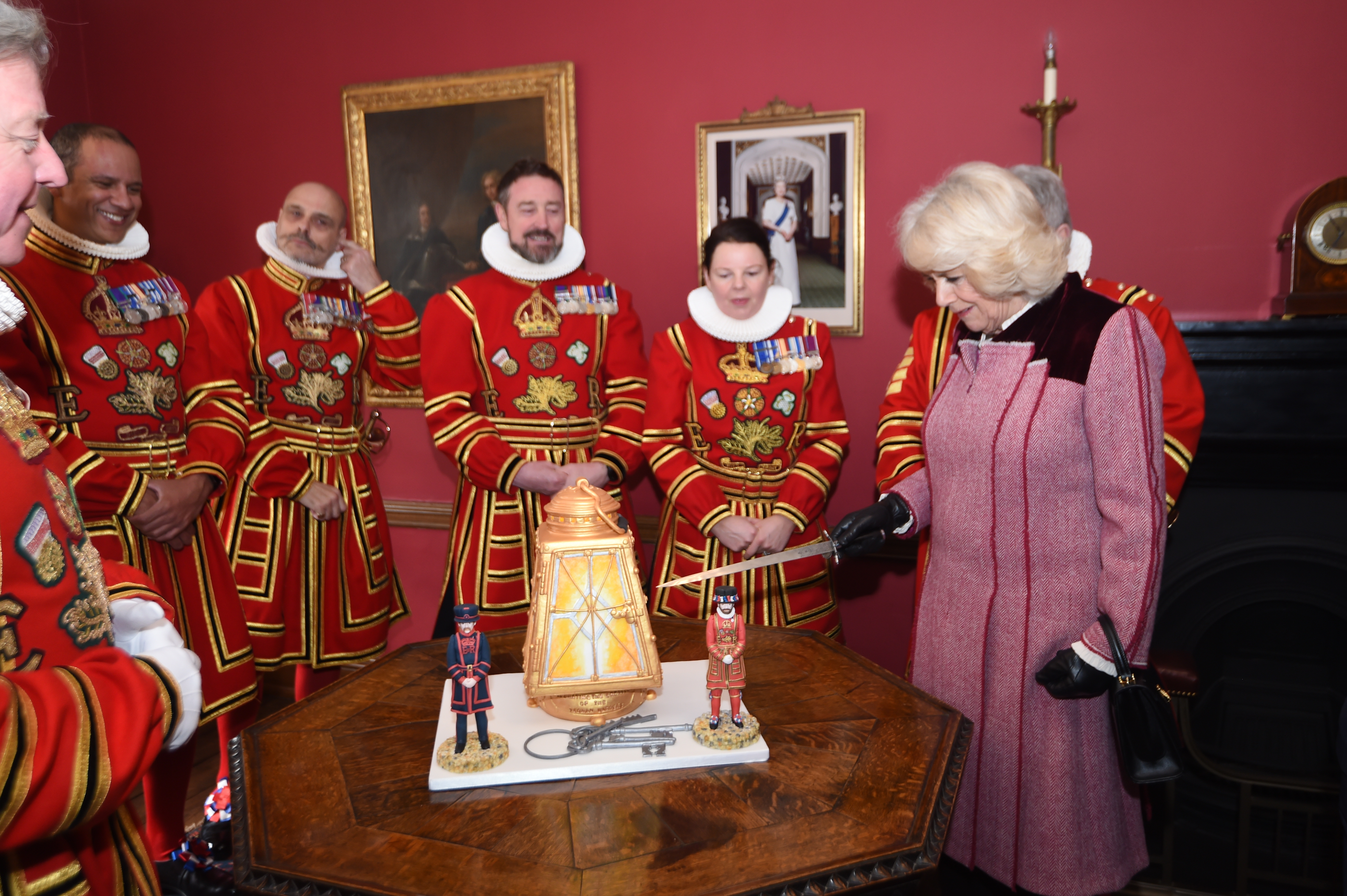 The Duchess of Cornwall cuts a cake at the Tower of London