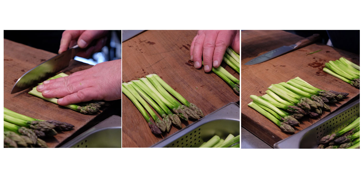 A chef in the Royal Kitchen at Windsor prepares Asparagus