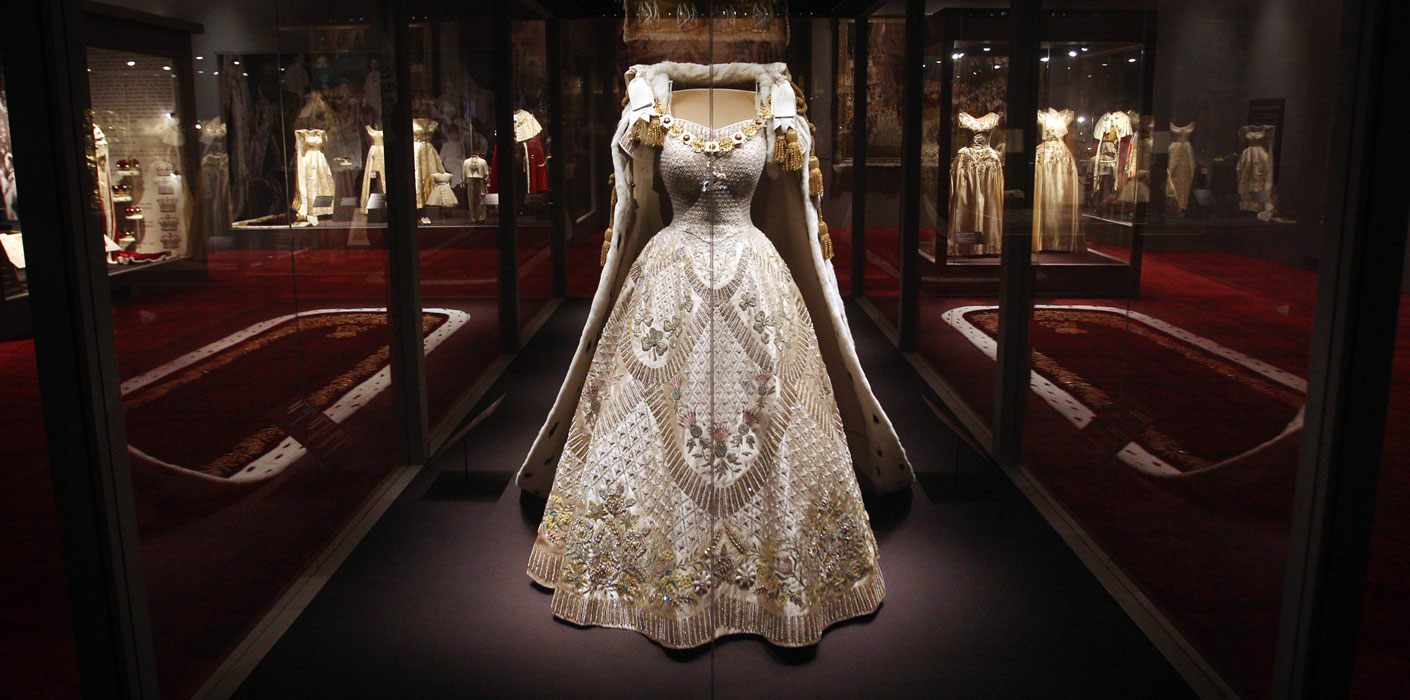 The Dress worn by Queen Elizabeth II at her Coronation was designed by Norman Hartnell