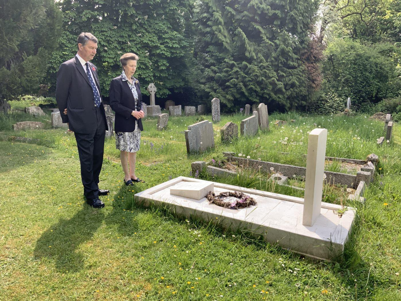 The Princess Royal and Admiral Sir Tim Laurence visit the grave of the Founder of the CWGC on VE Day