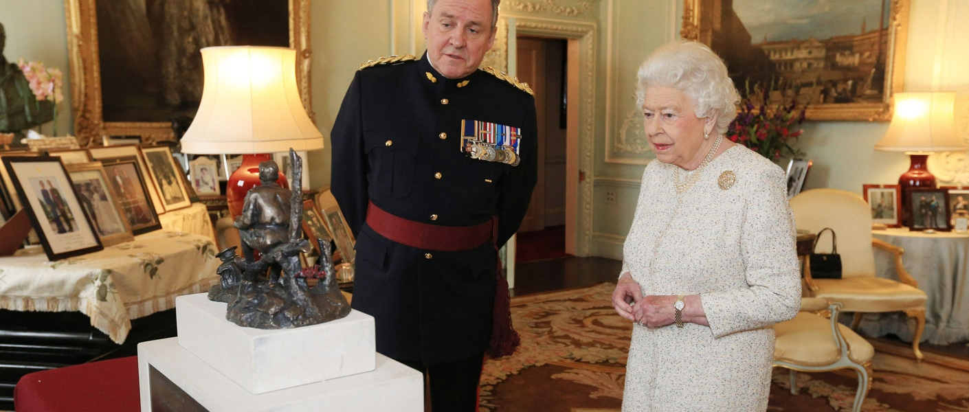 "The Queen receives a maquette of a statue of Canadian Lt. Col. John McCrae, best known for writing the famous war memorial poem ""In Flanders Fields""."