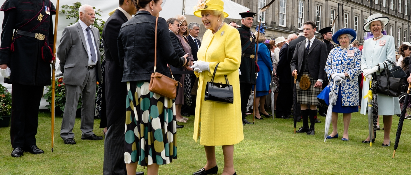 The Queen holds an Investiture and hosts a Garden Party at the Palace of Holyroodhouse