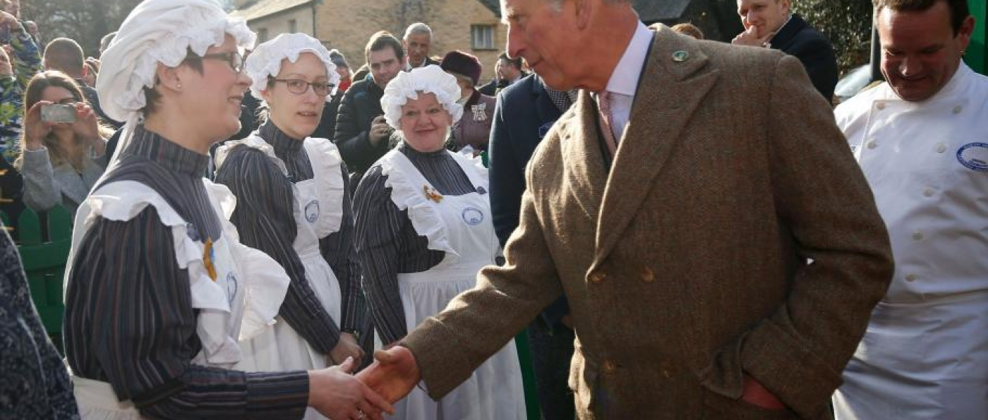 The Prince of Wales meets staff members at Grasmere Gingerbread Shop in Cumbria