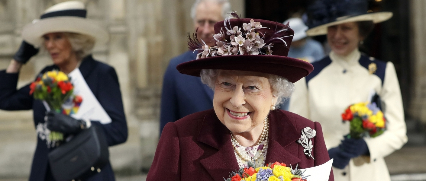 The Queen holding a posy outside Westminster Abbey