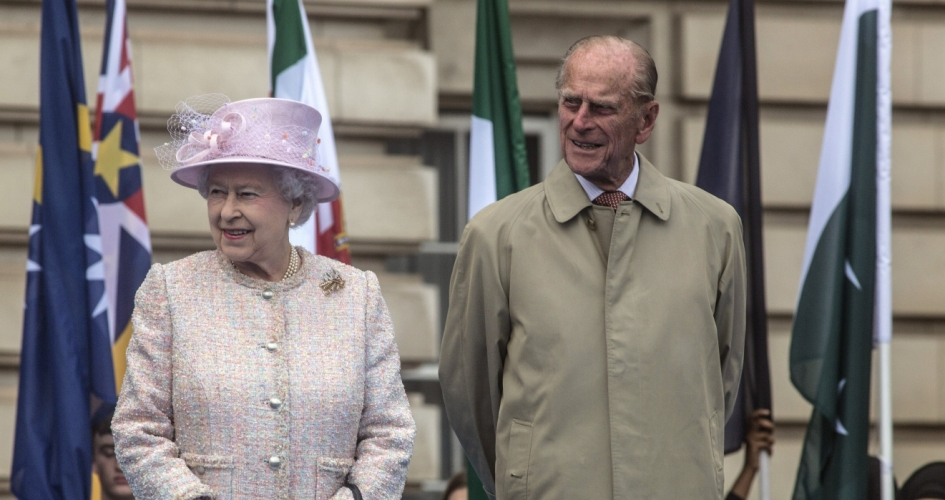 The Queen and The Duke of Edinburgh in front of Commonwealth flags