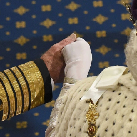 View fromabove of The Duke of Edinburgh taking The Queen's hand during State Opening