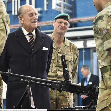 The Duke of Edinburgh, Colonel-in-Chief of the Royal Electrical and Mechanical Engineers (REME), speaks to a soldier who is demonstrating the operation of a gun during a visit the new home of REME at MOD Lyneham in Wiltshire.  The Duke of Edinburgh was visiting to officially name the new home of the Corps of REME in his honour,