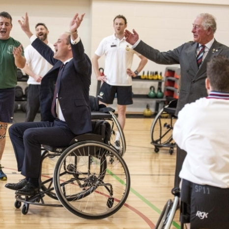 Sixth time lucky 🏀 The Duke of Cambridge scores in Wheelchair Basketball (with a little help from The Prince of Wales!) during a visit to the Defence Medical Rehabilitation Centre today.  Together with The Duchess of Cornwall and The Duchess of Cambridge, they met patients and staff at DMRC Stanford Hall, which rehabilitates some of the most seriously injured members of the Armed Forces, whilst also helping to return those who have been injured in the course of training to work.  It's not all about physical rehabilitation though — supporting the mental health of patients is also a key part of the recovery process, with several patients at centre using gardening as a form of therapy, and in the workshop woodworking and other practical skills helped people gain more confidence and learn new skills.
